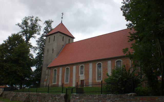 Budowo. Kościół gotycki pw. Najświętszej Marii Panny Królowej Polski, burzliwa historia